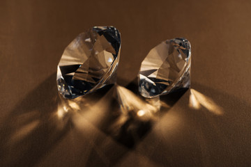 sparkling clear diamonds on brown background