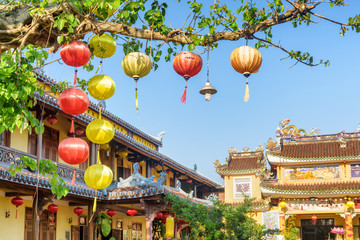 Beautiful yellow and red silk lanterns on green tree branches
