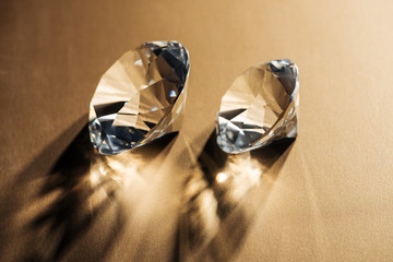 sparkling clear diamonds on golden background