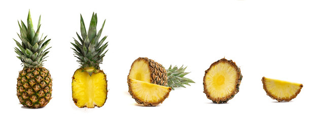 Fresh whole and cut pineapple isolated on white background