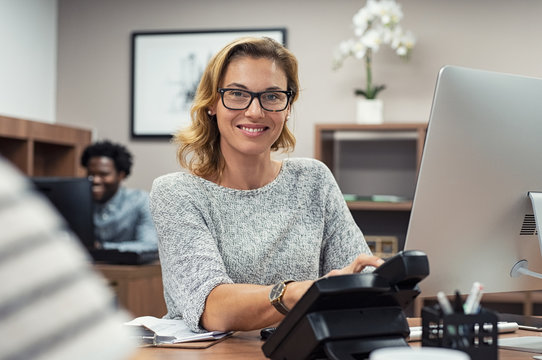 Mature casual woman working on computer