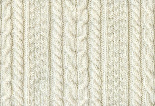 手編みの白のセーター 模様編みのテクスチャ