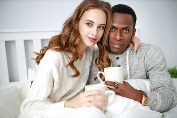 py loving couple drinking cocoa on winter morning in bed