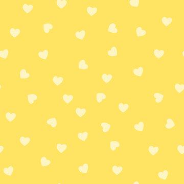 Seamless yellow heart pattern vector
