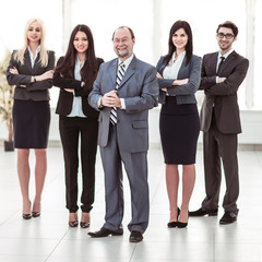 concept of success in business: professional business team on office background
