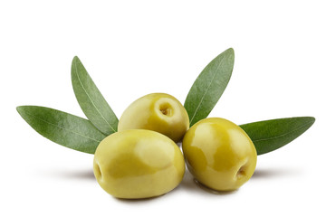 Green olives with leaves, isolated on white background Wall mural