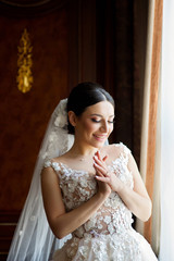 Beautiful young girl bride in a white wedding dress