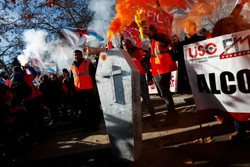 Workers of U.S. company Alcoa take part in a protest against the closure of two aluminium plants in northern Spain in front of Spanish Industry Ministry in Madrid