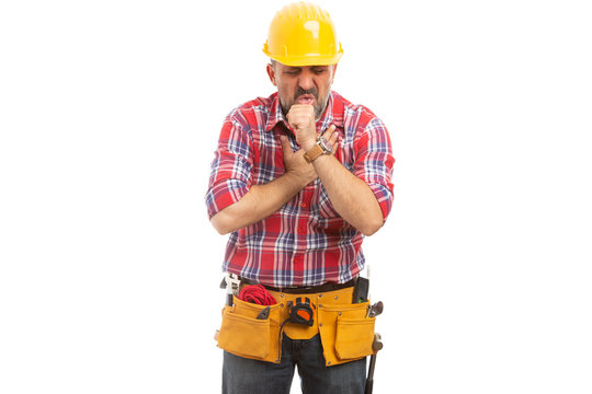 Builder coughing as out of breath.
