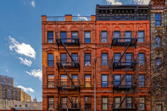 New-York building facades with fire escape stairs