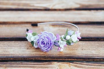 Handmade hoop purple flowers. Purple hair band on wooden background