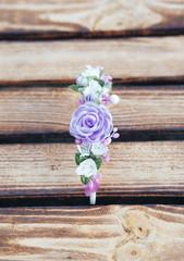 Handmade hoop purple flowers. Purple hair band on wooden background. Top view