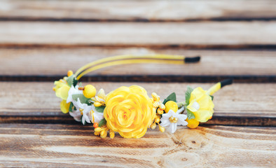 Handmade hoop Yellow flowers. Yellow hair band on wooden background