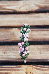Handmade hoop flowers. Pink hair band on wooden background. Top view