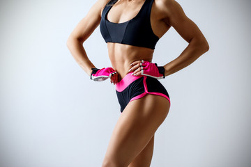 Athletic woman demonstrated her perfect muscular body.