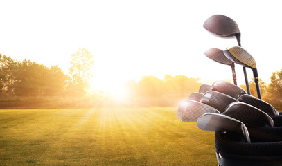 Fototapeten Golf Golf clubs drivers over beautiful golf course at the sunset, sunrise time. , morning time