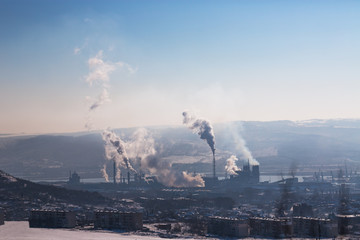 Chemical industry and working factory. Chimneys with smog in the sky. Air Pollution.
