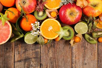assorted fruit on wood background