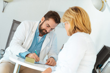 Doctor prescribing medicine to patient