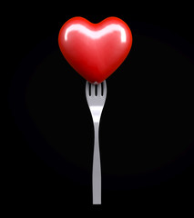 Heart on a fork isolated on black background