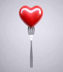 Heart on a fork isolated on gray background