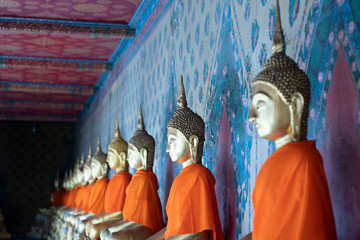 Fototapete - Ancient buddha statues inside Wat Arun temple in Bangkok, Thailand.
