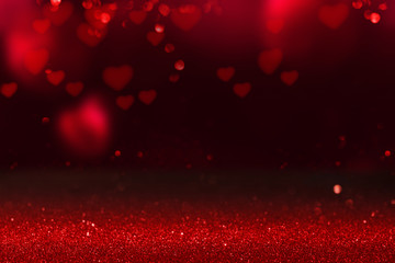 Red hearts on glittering background