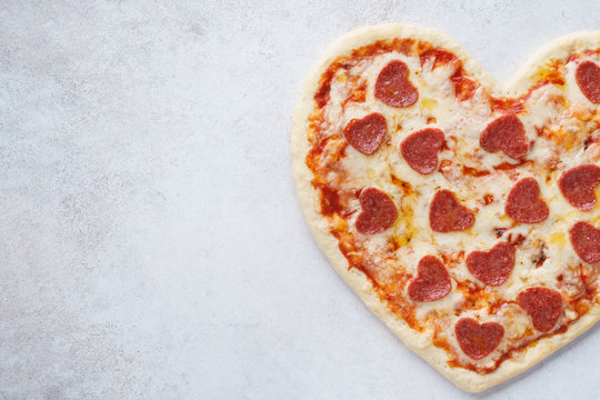 Baked heart shaped pepperoni pizza for Valentines Day.