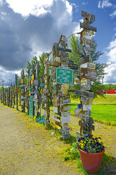 The Sign Post Forest is the famous attraction of Watson Lake on the Alaska Highway. Travelers from all over the world bring signs and put them on poles – Watson Lake, Yukon, Canada
