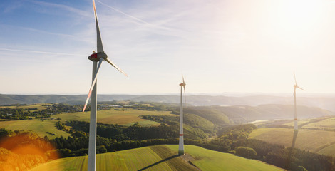 Wind turbine drone shot on a summer day - Energy Production with clean and Renewable Energy - aerial view