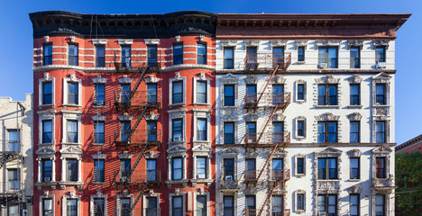 Panoramic view of old brick building against blue sky background in the East Village of Manhattan in New York City