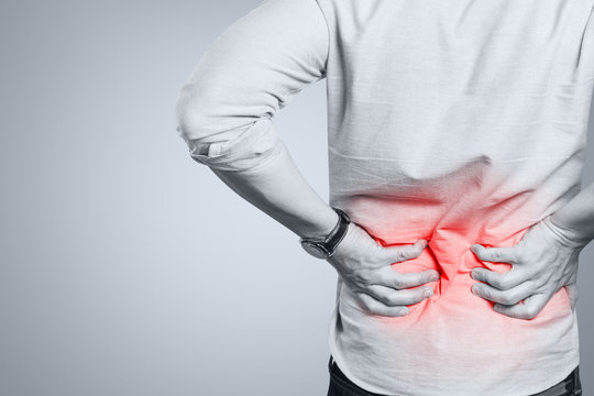 Man suffering from a lower back pain
