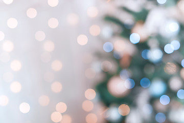 Blurred golden and blue festive lights. Christmas time concept.