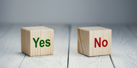 """Choice between two cubes with """"Yes"""" and """"No"""" on neutral background"""