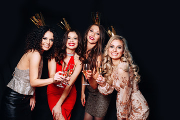 Four young beautiful women together celebrating party