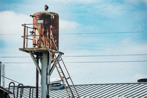 Old rusty tall water tank