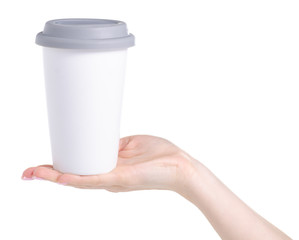 White cup mug with gray lid in hand on white background isolation