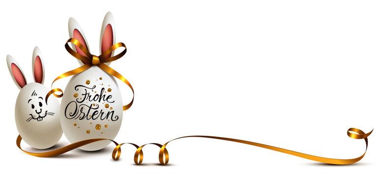 Ostereier mit Hasenohren, goldener Schleife und Kalligraphie mit Glitter Punkten - Grußkarte Frohe Ostern