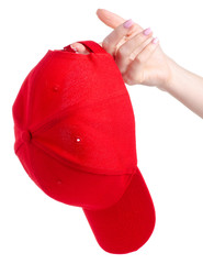 Red cap textile in hand on white background isolation