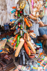 Balinese market. Souvenirs of wood and crafts of local residents. Colorful Souvenirs and figurines. Bali, Indonesia.