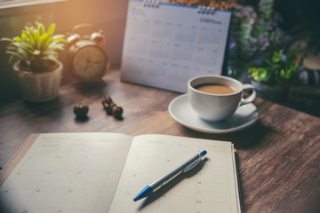 Planner and Calendar Concept.Desktop Calender 2019,cup of coffee place on office desk,working space.Notebook for Planner, timetable,agenda,appointment,organization,management each date,month and year