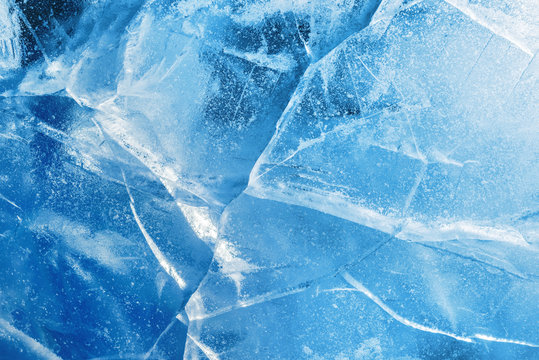 Abstract ice background. Blue background with cracks on the ice surface