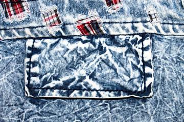 The texture of faded denim jeans with a pocket.Background of boiled denim.