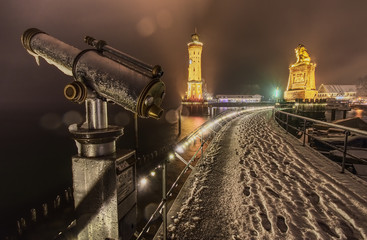 Lindau harbour night with snow and telescope