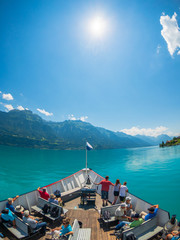 POV travelling by boat at Brienz lake at summer time