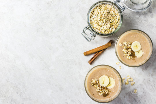 Peanut butter oatmeal breakfast smoothie. Selective focus, space for text.