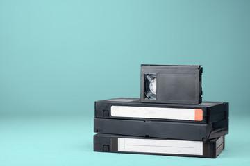 Several VHS videotapes on blue background