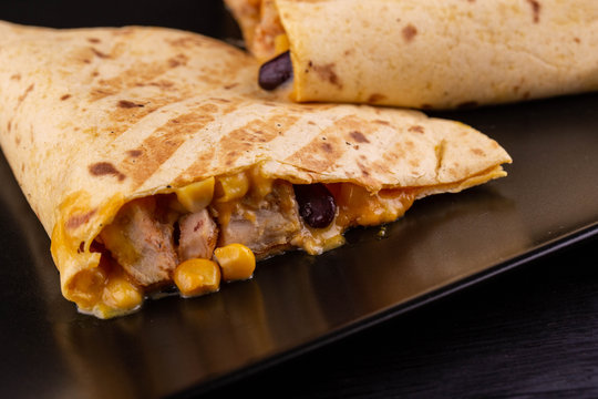 Quesadilla flat cakes with pieces of chicken, corn and black haricot