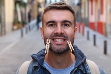Hypocrite man wearing a fake smile