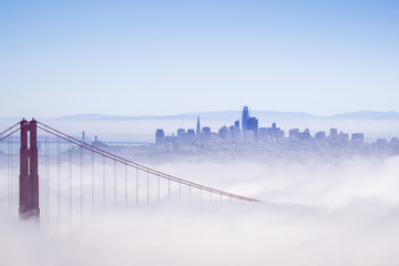 Golden Gate and the San Francisco bay covered by fog, the financial district skyline in the background, as seen from the Marin Headlands State Park, California Wall mural